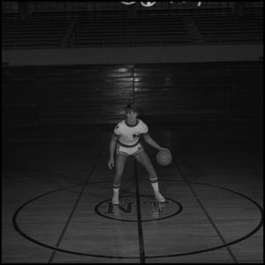 Primary view of object titled '[Tony Wright dribbling]'.