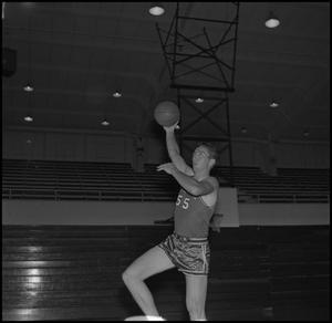 Primary view of object titled '[Butch Pruett tossing up basketball, 2]'.