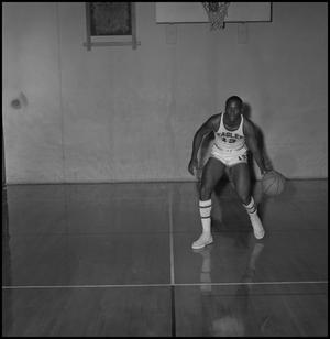 Primary view of object titled '[Dwight Lowery in mid-dribble, 2]'.