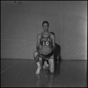 Primary view of object titled '[Ted Barnes kneeling with a basketball]'.