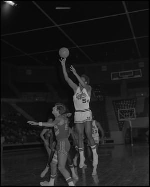 Primary view of object titled '[Stan Blackmon shooting a basketball]'.