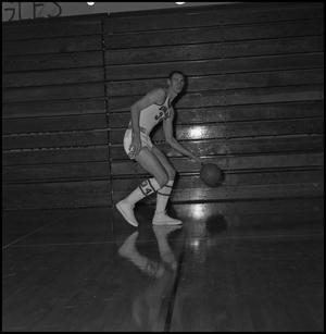 Primary view of object titled '[Carl Miller dribbling a basketball, 2]'.