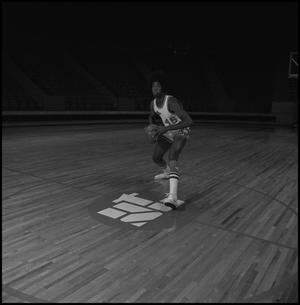 Primary view of object titled '[Basketball player preparing to shoot]'.