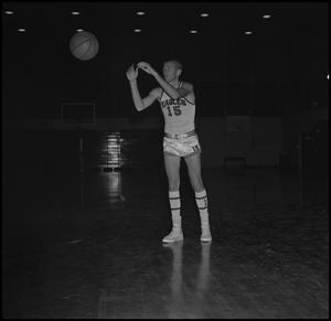 Primary view of object titled '[Eddie Davis catching basketball]'.