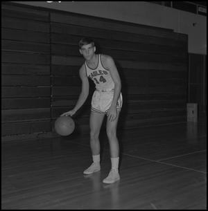 Primary view of object titled '[Freshman basketball player dribbling]'.