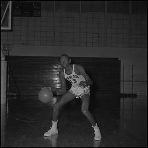 Primary view of object titled '[Robert Taylor dribbling a basketball]'.