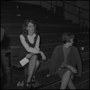 Primary view of object titled '[Women spectators at basketball game]'.