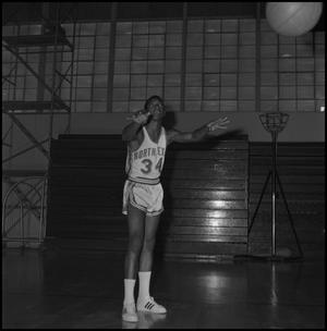 Primary view of object titled '[Roy Ford passing a basketball]'.