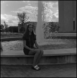 Primary view of object titled '[Jackie Barret - at the fountain before Willis Library]'.