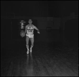 Primary view of object titled '[Billy Hughes dribbling a basketball]'.