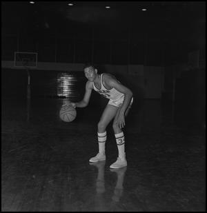 Primary view of object titled '[Willie Davis dribbling basketball, 2]'.