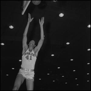 Primary view of object titled '[Willie Davis going to catch basketball]'.