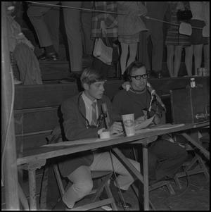 Primary view of object titled '[Commentators at NTSU Basketball Game]'.