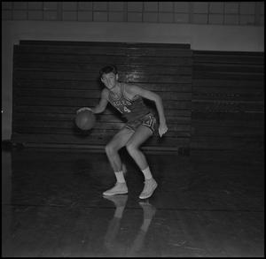 Primary view of object titled '[John Jones dribbling a basketball, 2]'.