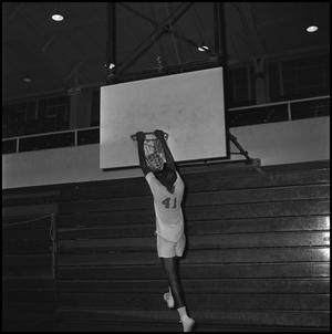 Primary view of object titled '[Basketball player hanging off hoop]'.