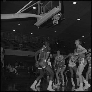 Primary view of object titled '[Basketball Players watching Ball Through Hoop]'.