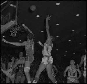 Primary view of object titled '[Basketball Players Against Louisville]'.