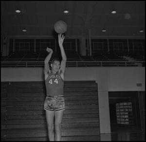 Primary view of object titled '[Bob Burns shooting a basketball, 2]'.