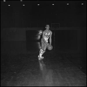 Primary view of object titled '[Carroll Carlisle dribbling basketball on court]'.