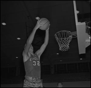 Primary view of object titled '[Lew Thornbrough dunking basketball]'.