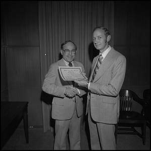 Primary view of object titled '[President Nolen presents Dr. John Allen with the Honor Professor Award, Honors Day, April 25, 1975]'.