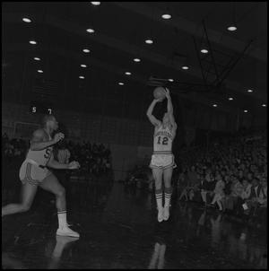 Primary view of object titled '[North Texas State Basketball Player Jumping to Make Shot]'.