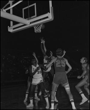 Primary view of object titled '[Basketball Game in Coliseum North Texas Eagles vs Samford Bulldogs]'.