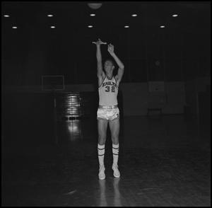 Primary view of object titled '[Johnny Burks throwing basketball into air]'.