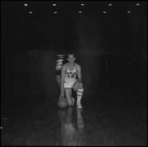 Primary view of object titled '[Carroll Carlisle kneeling with basketball, 2]'.
