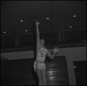 Primary view of object titled '[Willie Davis shooting a basketball, 2]'.