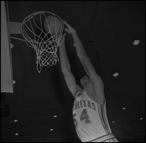 Primary view of object titled '[Basketball player Willie Davis dunking ball]'.