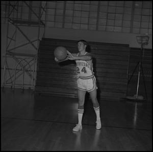 Primary view of object titled '[Neil Adams passing a basketball]'.