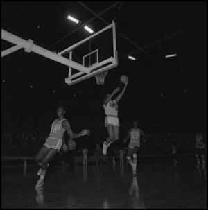 Primary view of object titled '[Eagles Basketball Player Jumping Up To the Hoop]'.