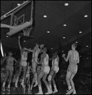 Primary view of object titled '[North Texas Basketball Players against Okla City]'.