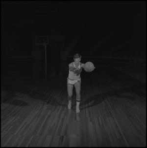 Primary view of object titled '[Glenn Buntin passing a basketball]'.