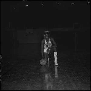 Primary view of object titled '[Albert Jones kneeling with his basketball]'.