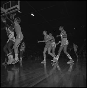 Primary view of object titled '[NTSU Men's Basketball Players vs UTA]'.