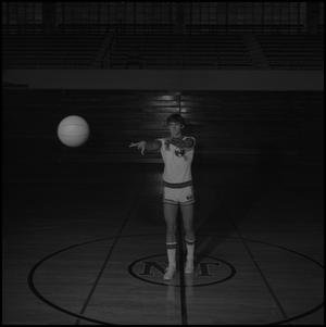 Primary view of object titled '[Randy Felhaber passing a basketball]'.