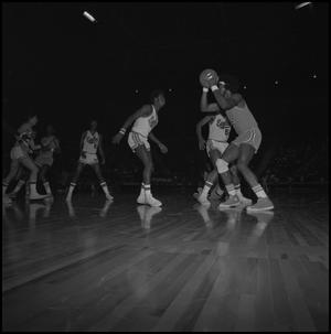 Primary view of object titled '[Men's Basketball Game against UTA in Coliseum]'.