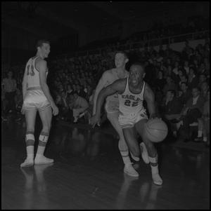 Primary view of object titled '[Oscar Miller during a basketball game]'.