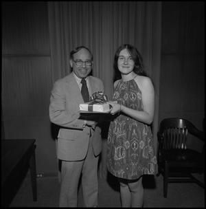Primary view of object titled '[President Nolen presents an award, Honors Day, April 25, 1975]'.