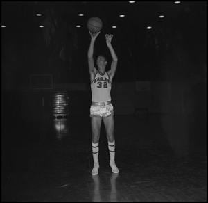 Primary view of object titled '[Johnny Burks throwing basketball into air, 2]'.