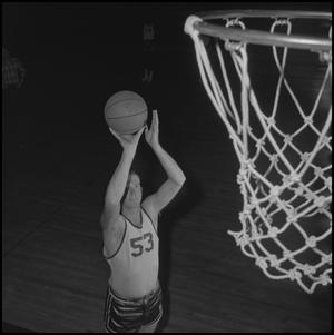 Primary view of object titled '[Wayne Hopkins Tossing Up Basketball]'.