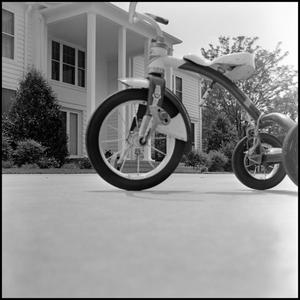 Primary view of object titled '[Tricycle in front of the President's House]'.