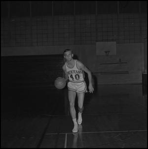 Primary view of object titled '[James K. Wilson dribbling basketball]'.