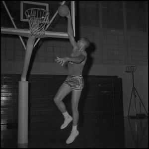 Primary view of object titled '[Wille Davis going to dunk basketball, 2]'.
