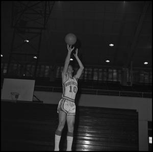 Primary view of object titled '[Doug Willoughby shooting a basketball]'.