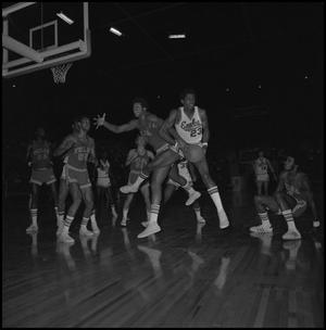 Primary view of object titled '[Eagles Basketball Player Intercepts Ball From Opponents]'.