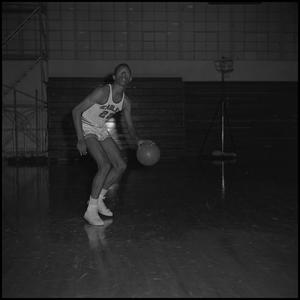 Primary view of object titled '[Roy Ford dribbling a basketball]'.
