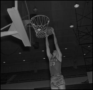 Primary view of object titled '[Dale Abshire going to dunk ball into hoop]'.